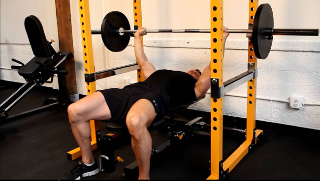 bench pressing in a rack