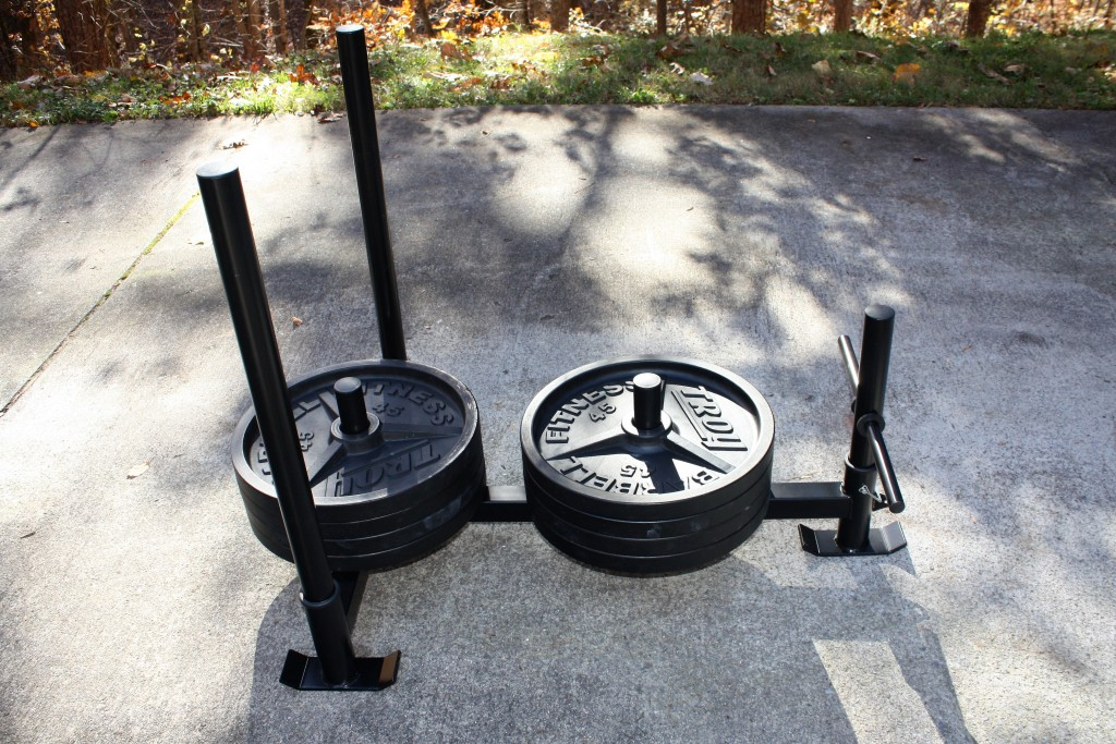 Fringe Sport Econ Prowler loaded with Troy weight plates