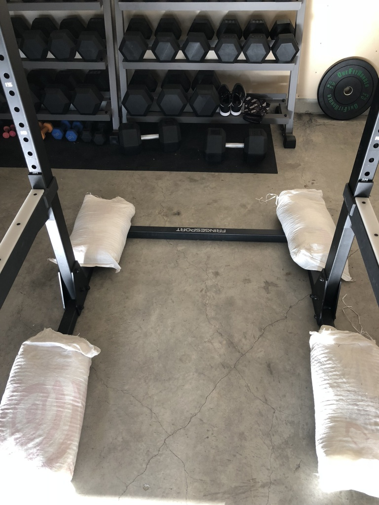 sandbags to weigh down squat rack
