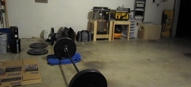 Troy bar and VTX bumper plates, using towels and cardboard as a platform