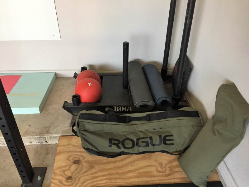 Dog Sled, Echo Slam Balls, yoga mats, and Sandbags