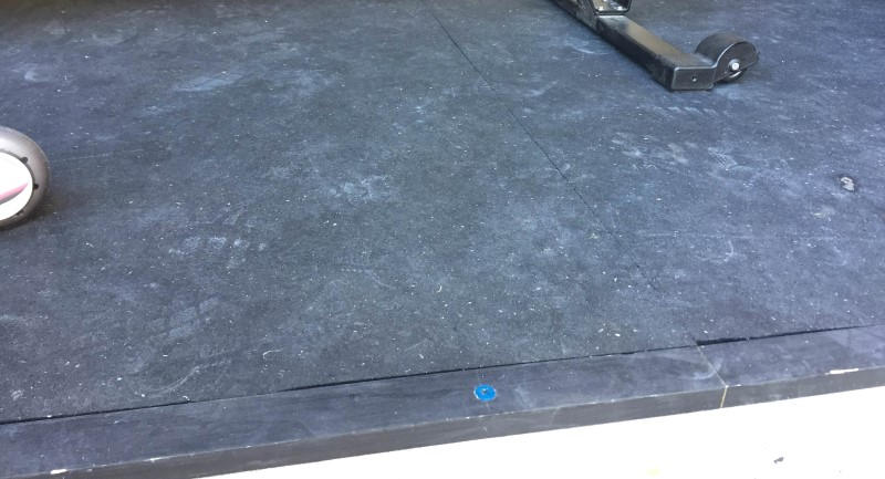 2x1 boards to keep stall mats from sliding in garage gym