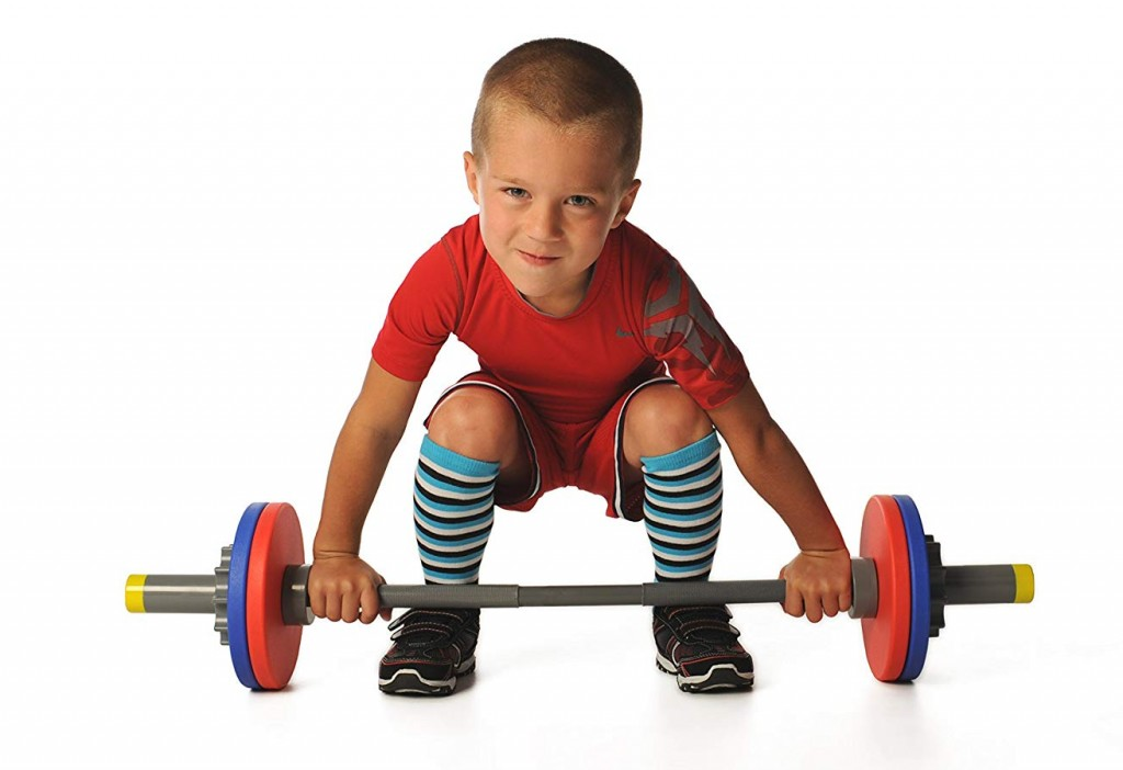 Toddler or small child lifting with junior play barbell set