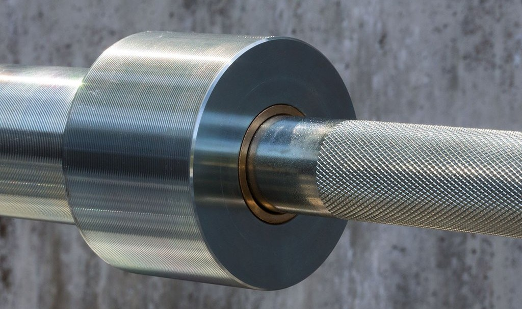 The bar's knurling stops short of the shoulders, usually an indication of a cheap barbell