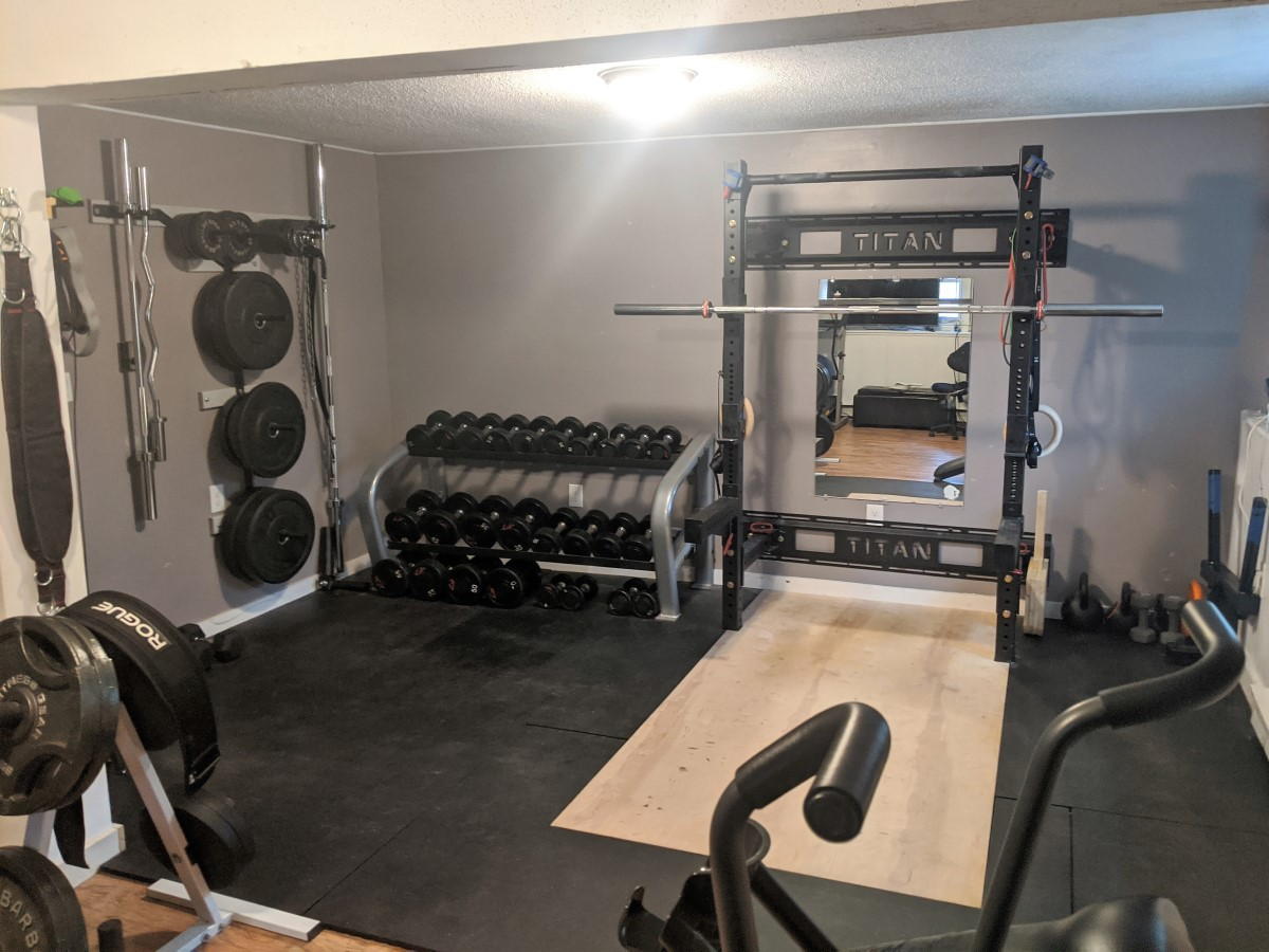 folding squat rack basement gym