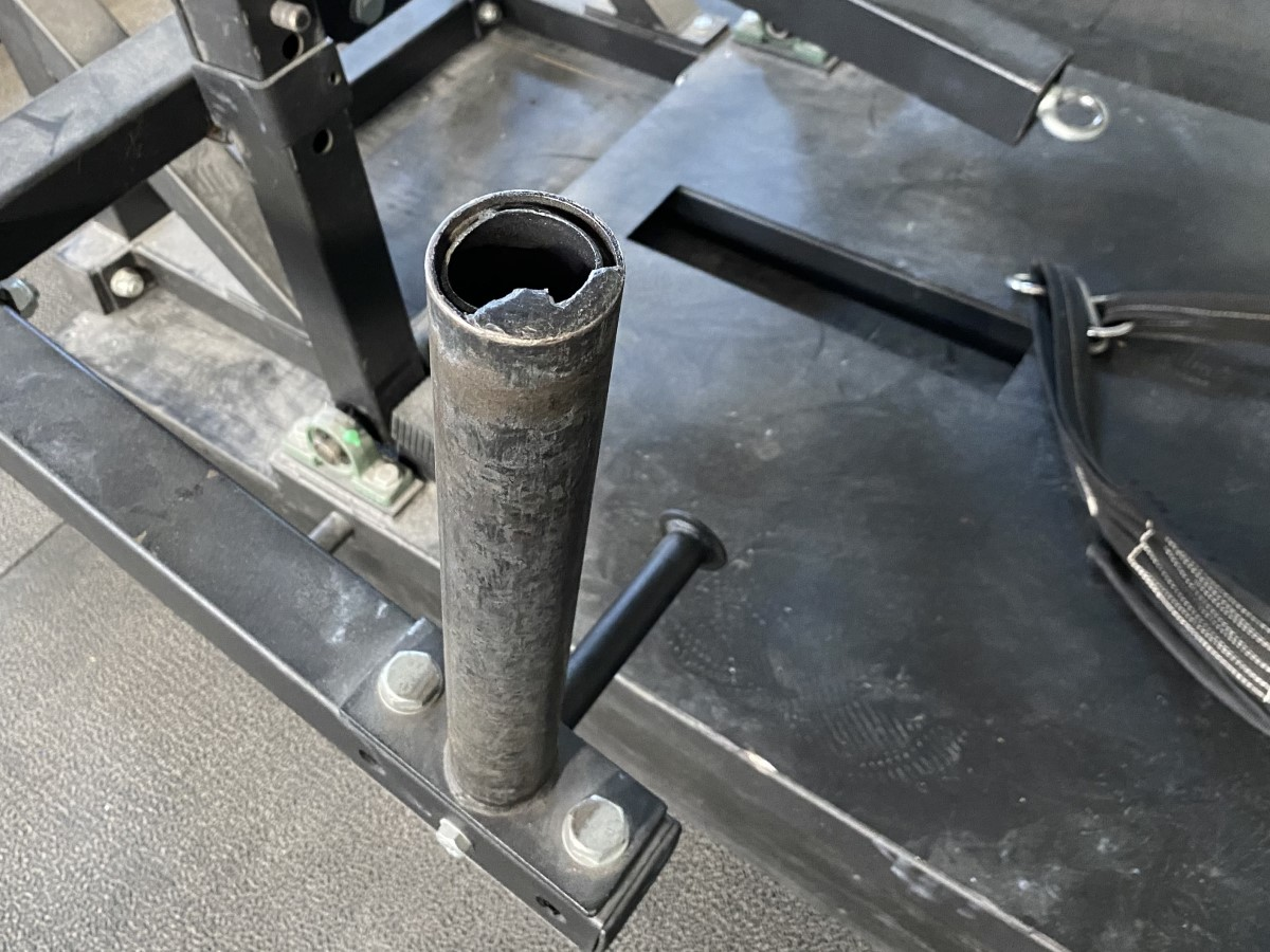 Damaged end cap on weight peg