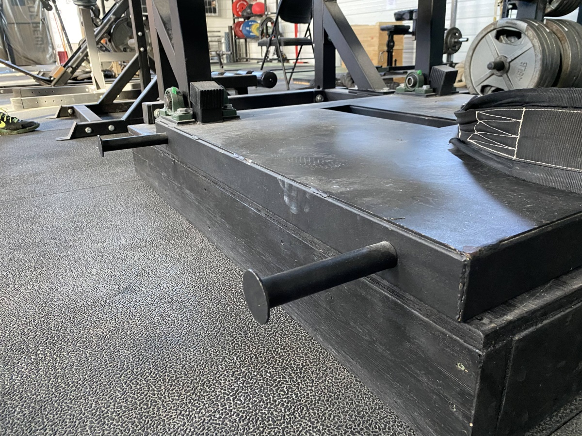 elevated platform to fix belt squat machine range of motion issue