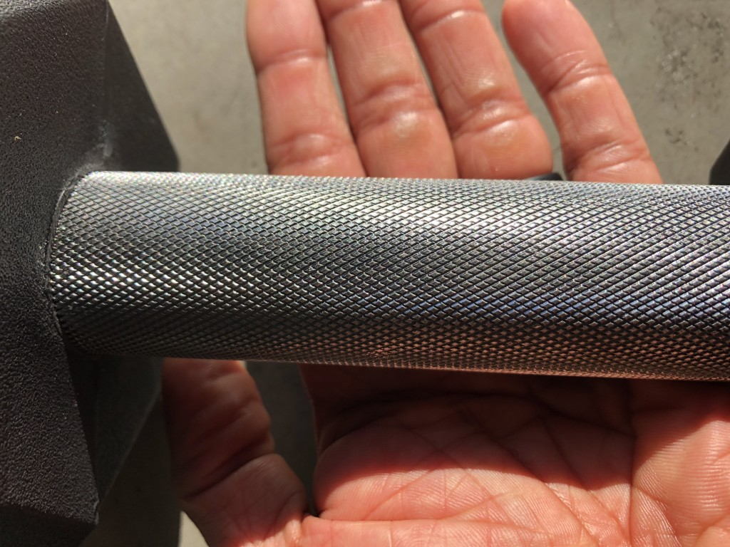 knurling of Rep rubber hex dumbbells
